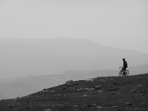 Lone Cyclocross rider on the summit of Ingleborough.